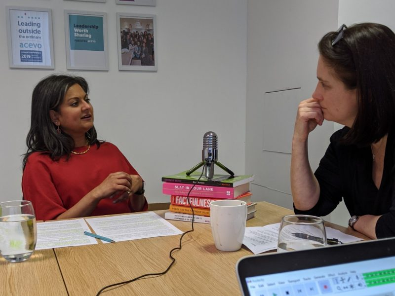 Aleema Shivji and Vicky Browning having a chat which is being recorded, there is a microphone between them