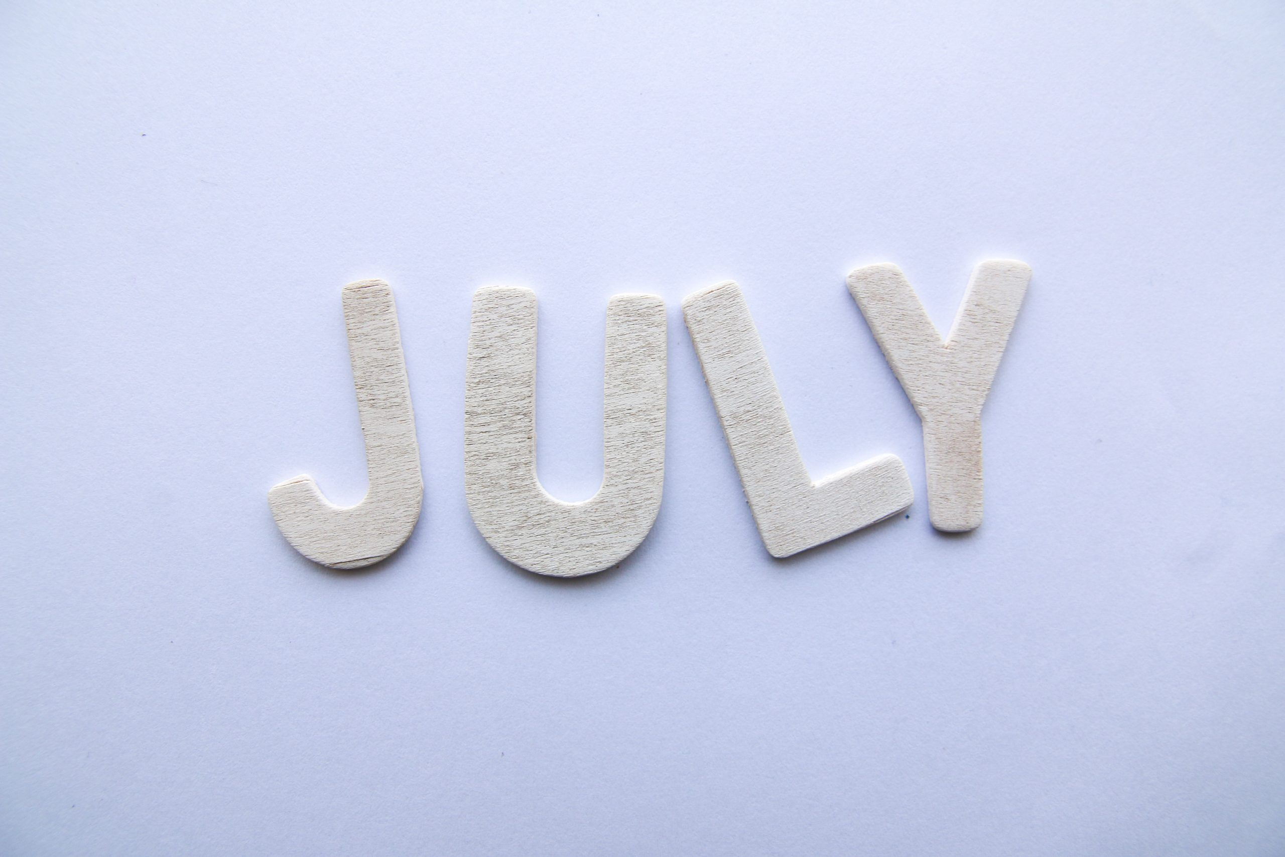 the word 'July' written using paper cuts