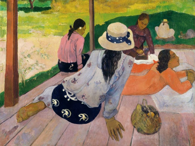 Painting by Paul Gauguin. Women are sitting on what it looks like a patio, relaxing.