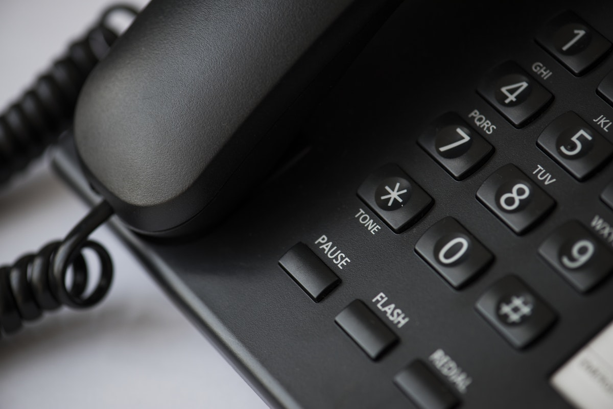 Close up of a black landline telephone